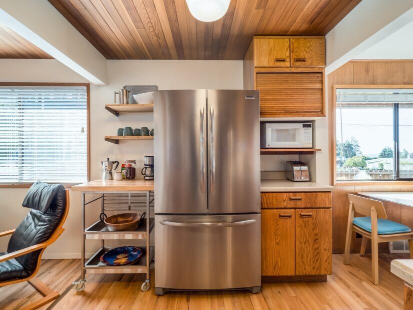 Coffee, tea, fridge, and microwave next to breakfast area