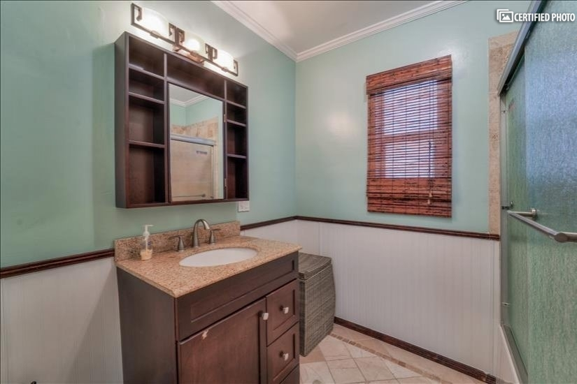 Secondary bathroom, fully updated with soaking tub.