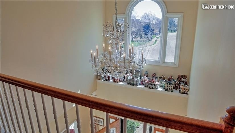 Two Tier foyer entry illuminated with crystal chandelier