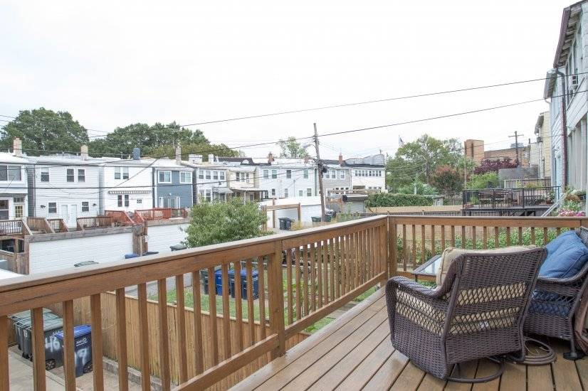 Deck with patio furniture and grill