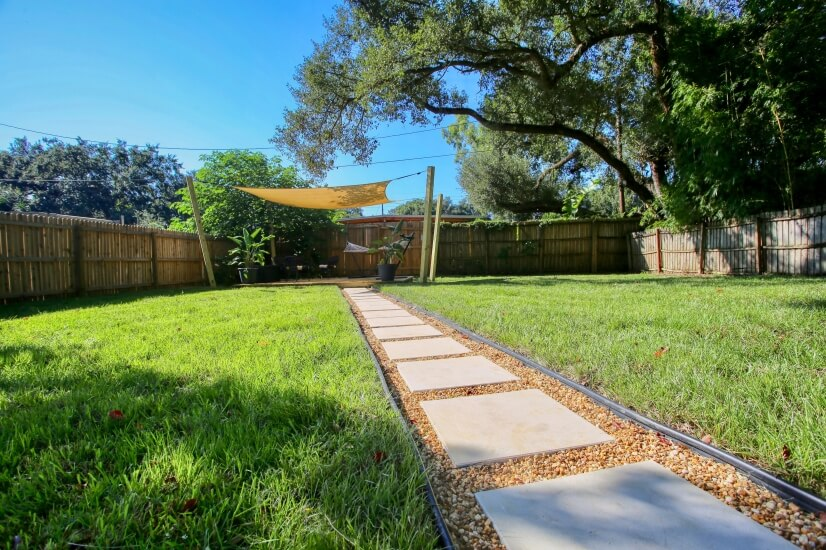 Huge, fully-fenced back yard, mowed Mondays