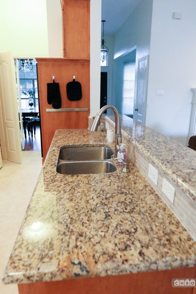 Stainless sink with retractable faucet and high power garbag