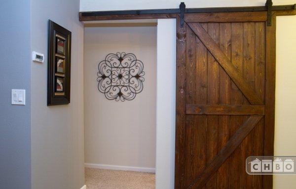 Trendy Barn Door and Bedroom Hallway