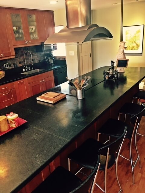 Seating for 10 at the kitchen bar - honed granite counters