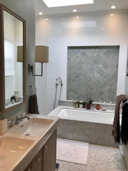 Master bathroom with heated floors, bathtub, walk in closet