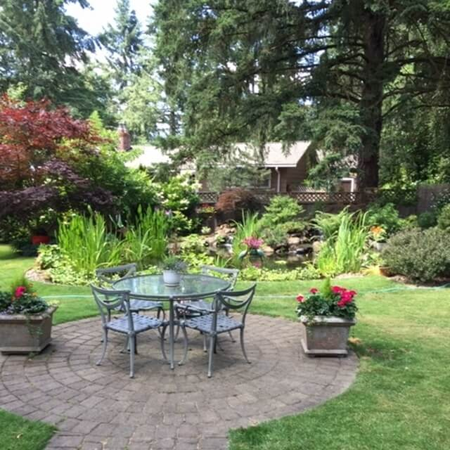 Table/chairs to enjoy the pond & backyard