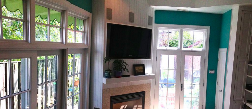 Playroom has flat-screened TV and working fireplace
