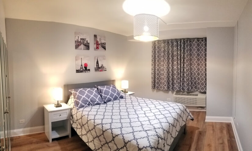 Clean bedroom with full closet organizer