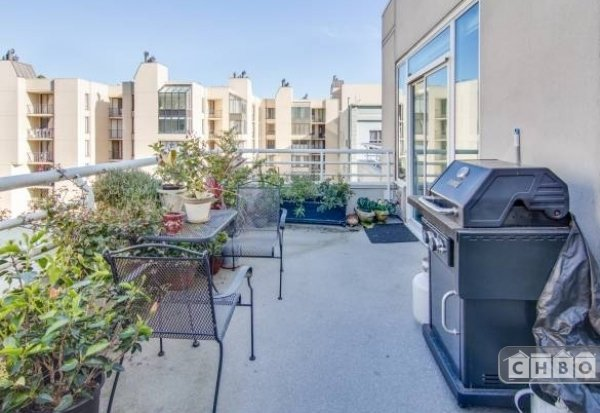 Main patio with propane grill off of the living and dining r