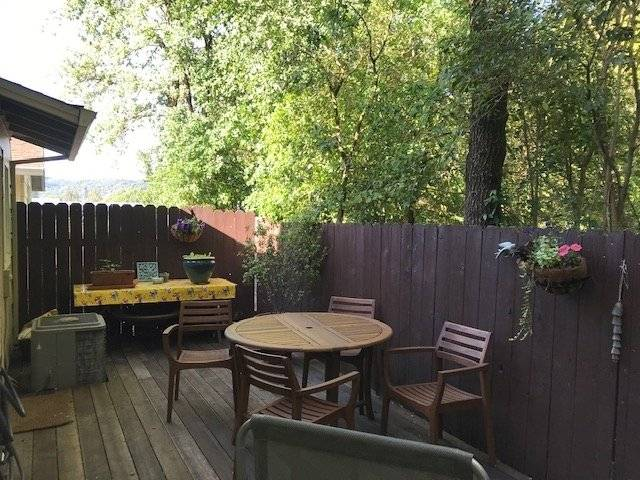 Back deck with dining area and view of Mayacamas Mountains.