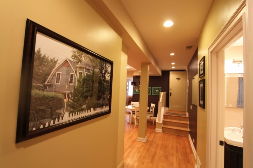 A long hall way separates the living area from the bed rooms