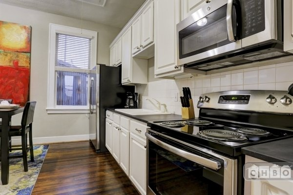 kitchen has all new stainless appliances