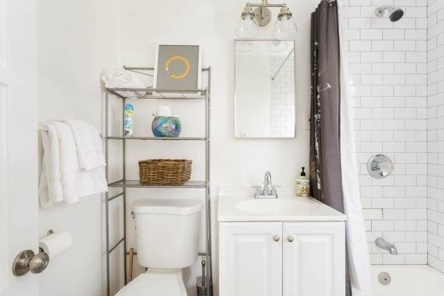 Bathroom with tub/shower, tile floor and subway tile walls