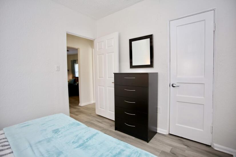 Nightstand, alarm clock, ceiling fan, closet & dresser incl.