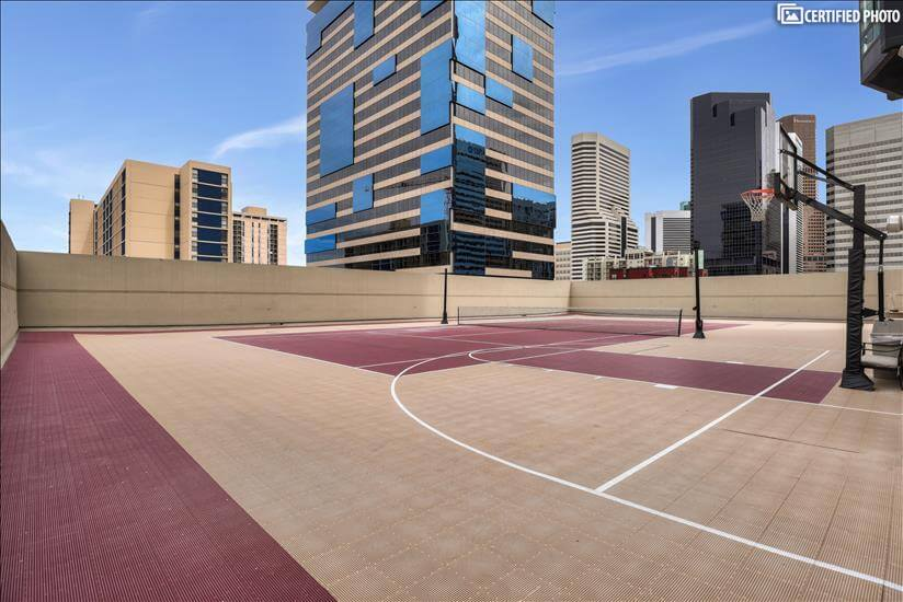 Tennis and basketball court on fifth floor of building