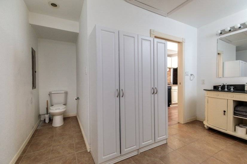 WC alcove and large amounts of storage.