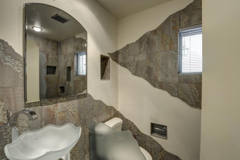 Full bathroom #1 with custom tile and rain shower