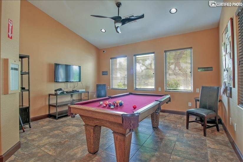 Clubhouse pool table and game room with TV