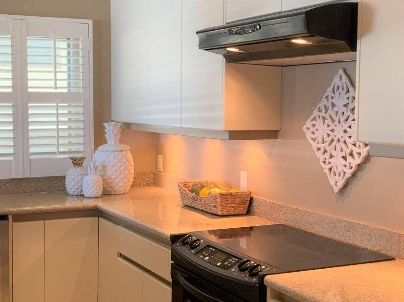 Large appliances and wood shutters in kitchen