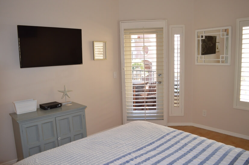Bedroom with door out to balcony