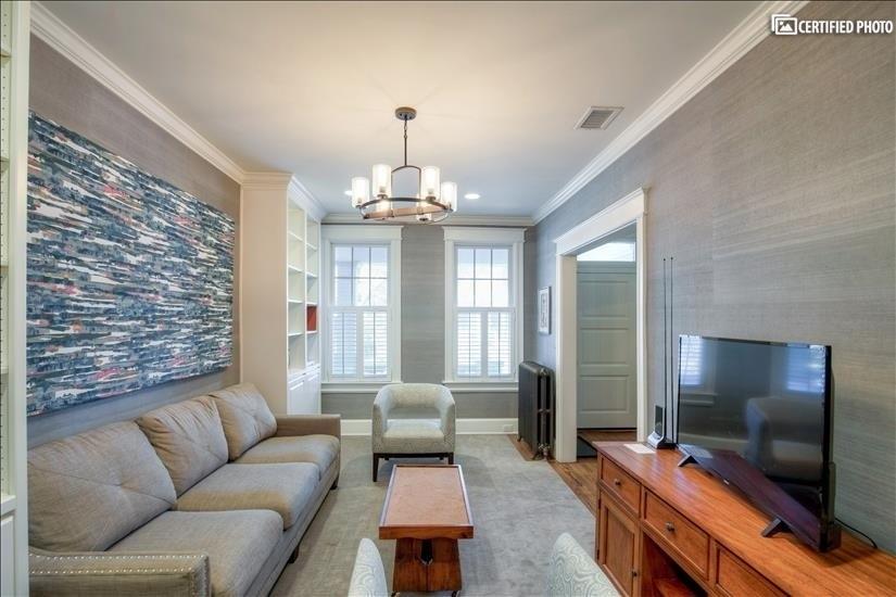 Main floor living room has a Queen sleeper sofa
