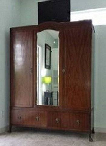 Antique wardrobe, TV with full cable package