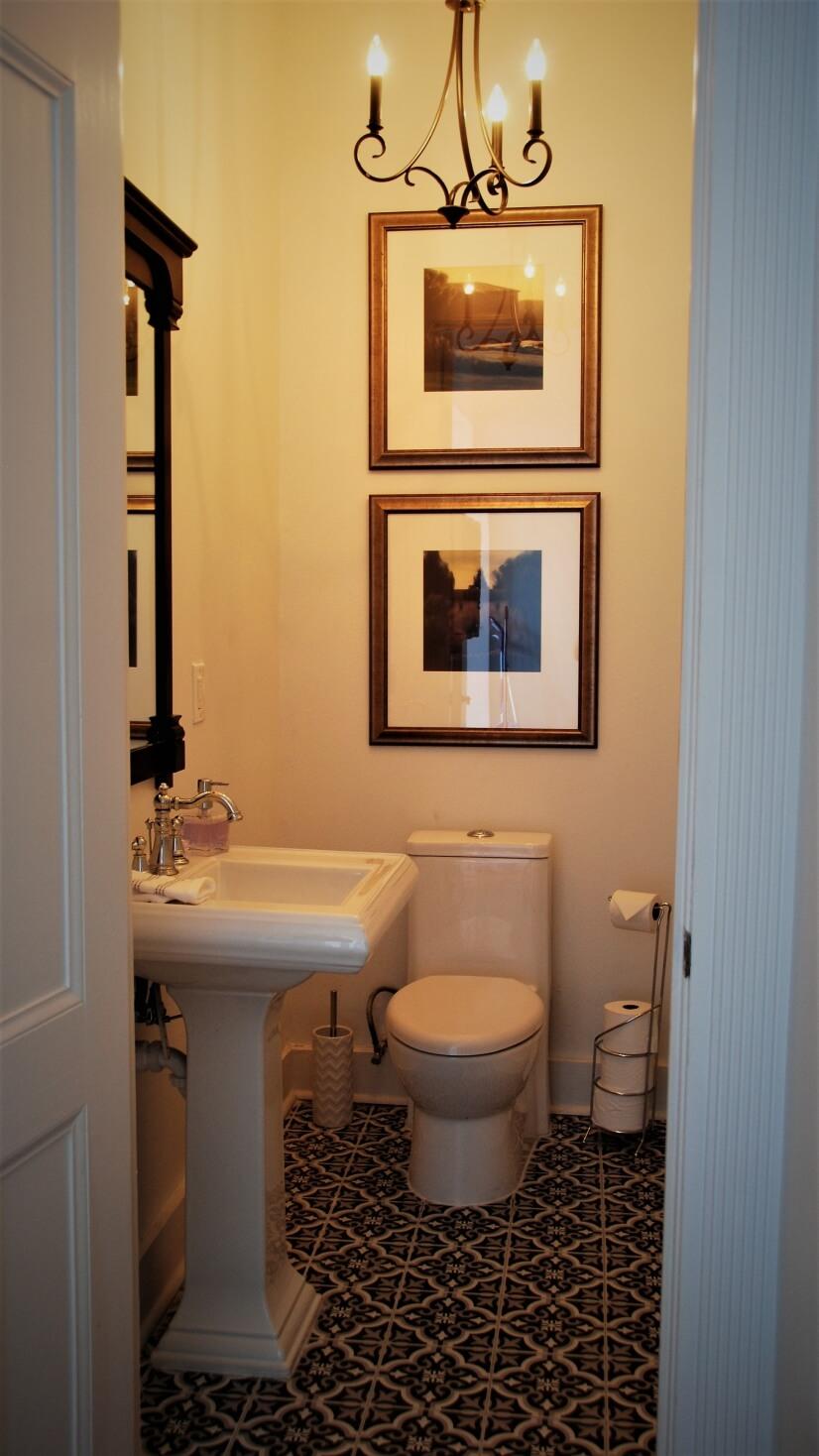 Black n' White Tiled Powder Bath featuring Pedestal Sink