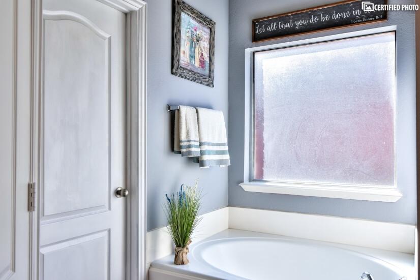 Master tub adjacent to huge master closet