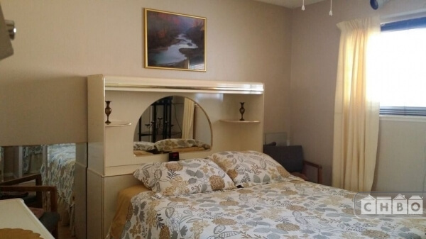 Beige bedroom with queen bed