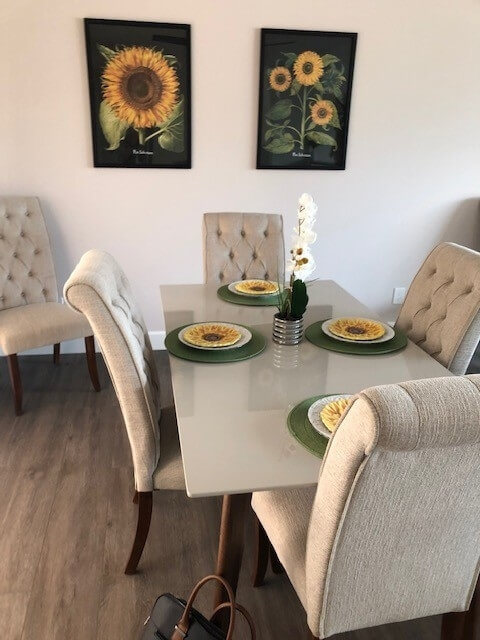 Dishes, art and comfortable dining furniture