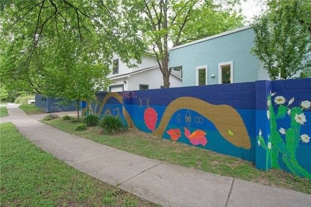 Austin aritist painted mural on property exterior