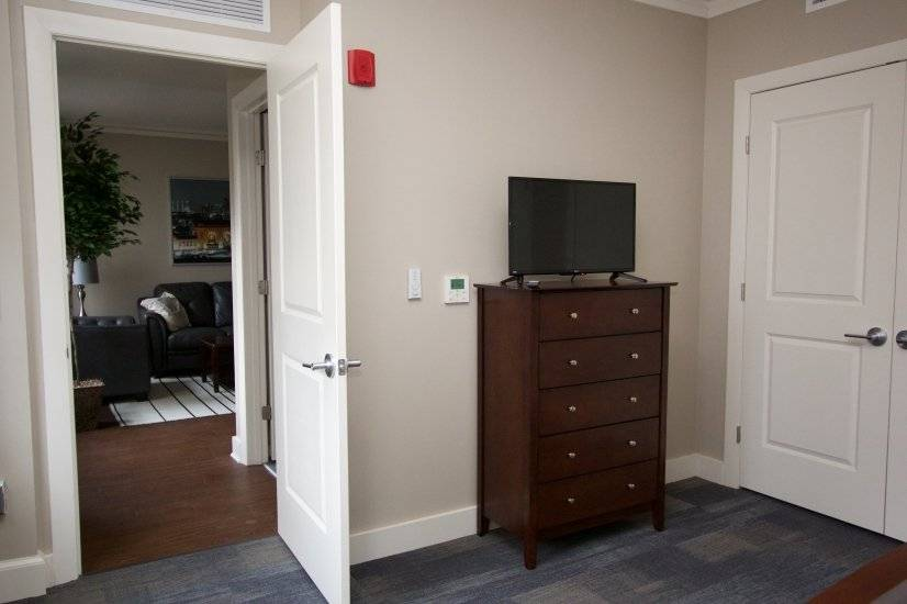 First bedroom TV and Chest of Drawers