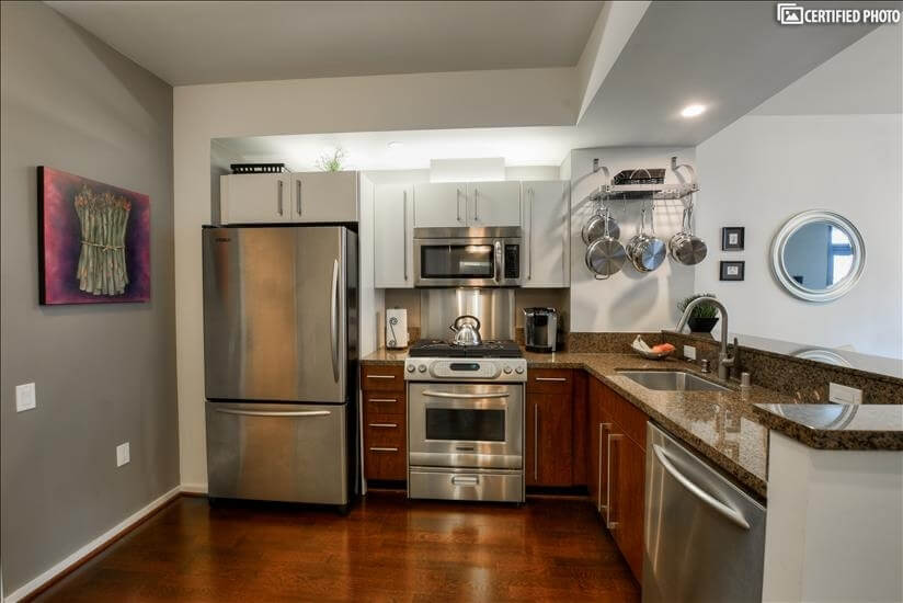 Fully equipped kitchen with stainless steel appliances.