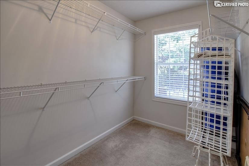 Over-sized walk-in closet w/ hanging shelves