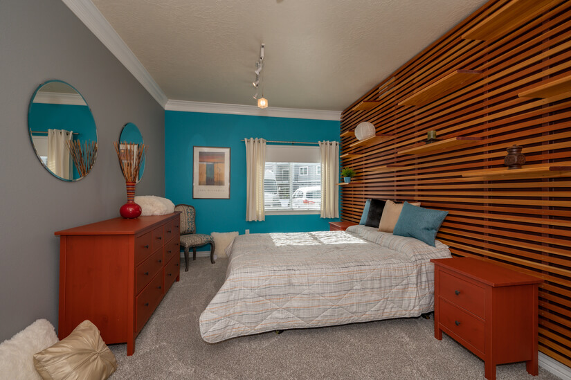 Master bedroom with cherry wood feature wall