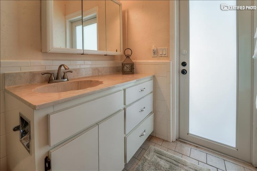 Master bathroom offers exit out to pool deck for easy access