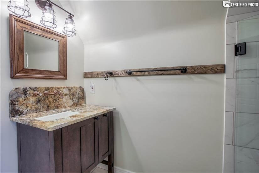 Upstairs - granite topped vanity with copper faucet