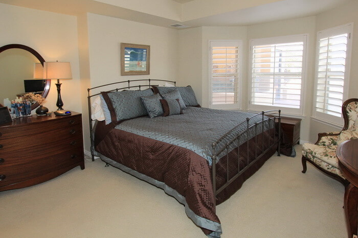 Master bedroom with king bed, solid wood.