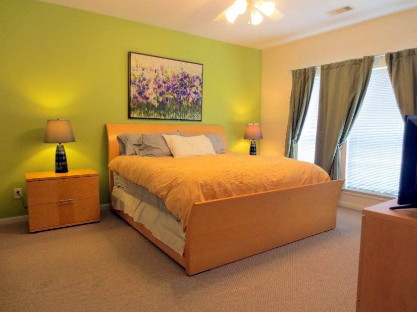 Master bedroom on 3rd level, king sized bed.