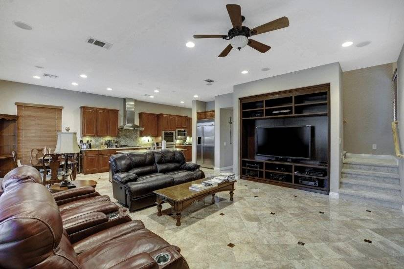 "Fam room ,kitchen, 70"" tv, motion Chairs, outdoor tv boxes"