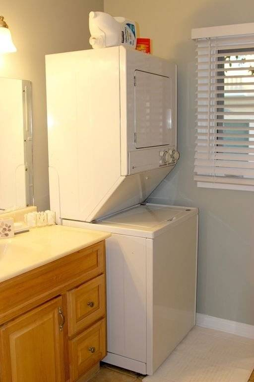 washer and dryer located in bathroom