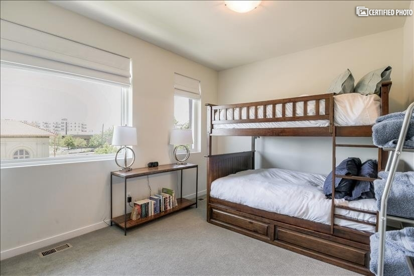 Two full-size beds in bunk with a trundle bed  underneath