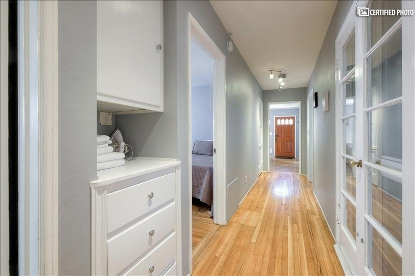 Hallway Storage cabinet with 2 large walk in closets in hall