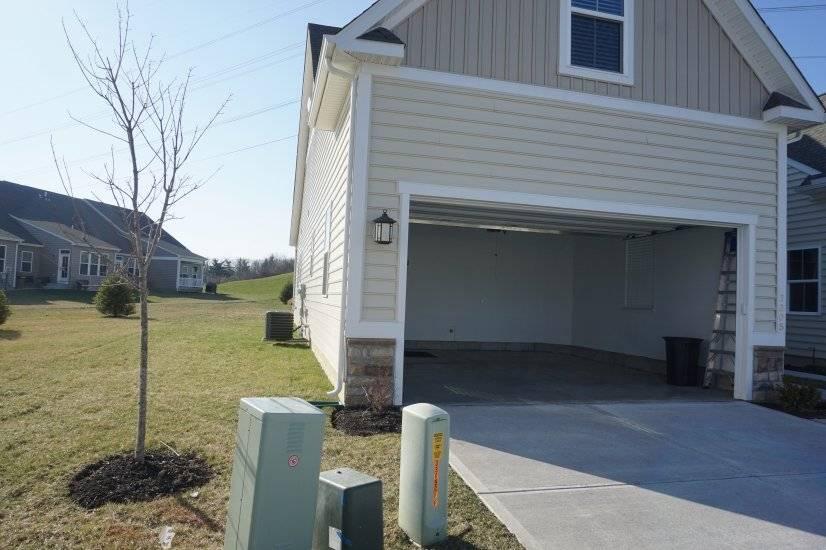 Two Car Garage with a yard