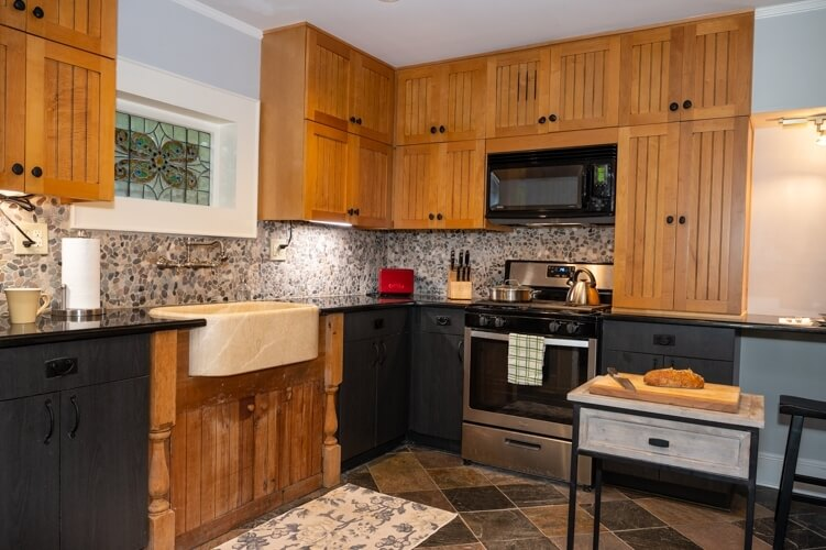 Spacious kitchen with granite counters, stone