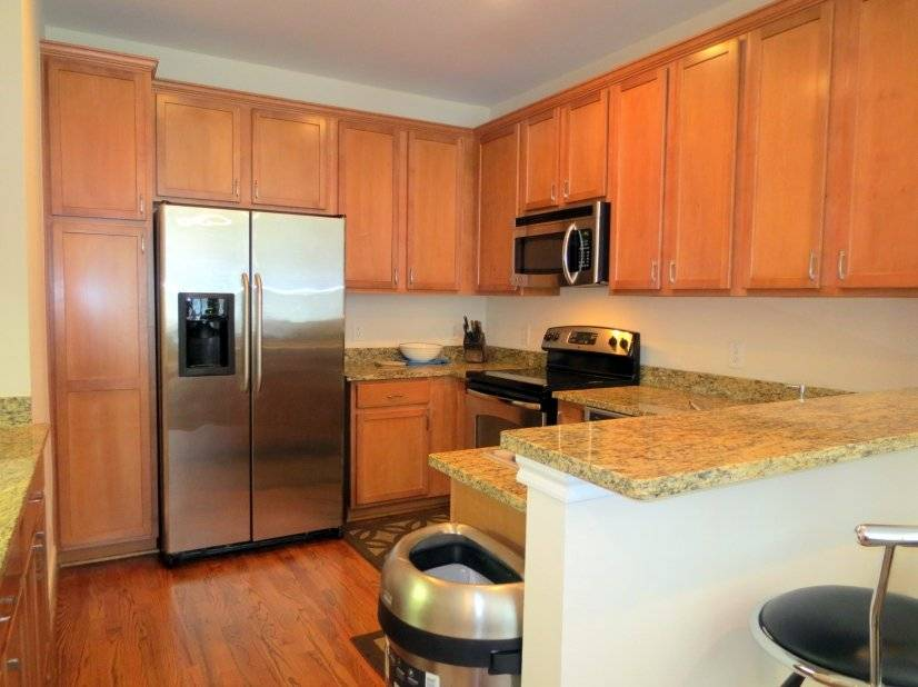 Kitchen on 2nd level with granite counter top.