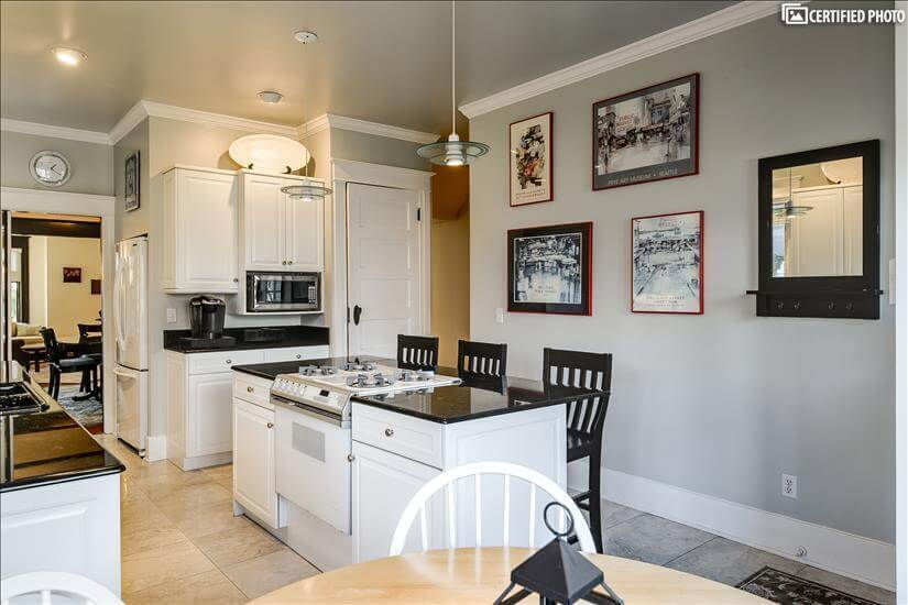 Full stocked kitchen with island and seating.