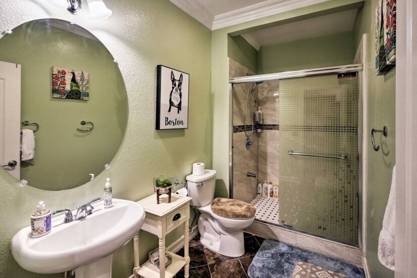 The first floor bathroom offers a walk-in sho