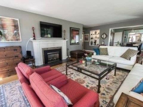 """Gas Fireplace and 55"""" Flatscreen TV  in Living Room"""