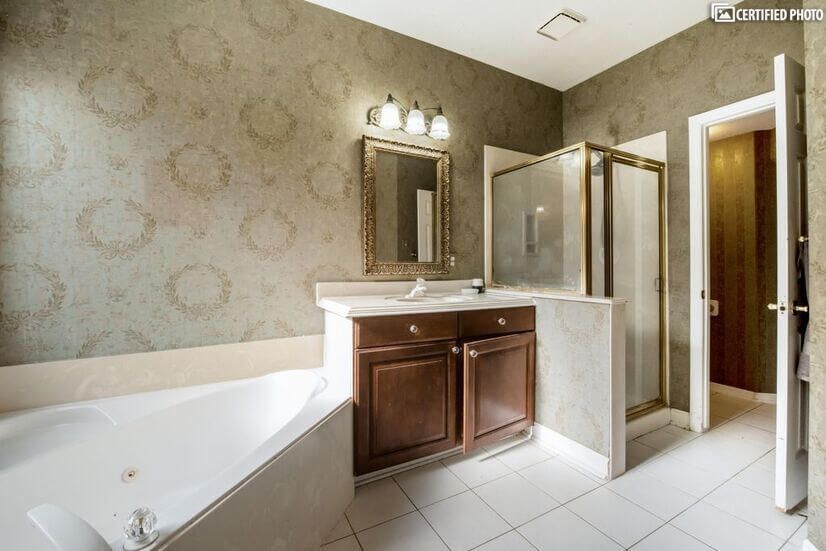 Separate large standup shower with huge walk